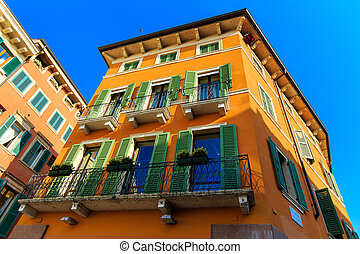 old traditional house in Verona, Italy on a background of blue s