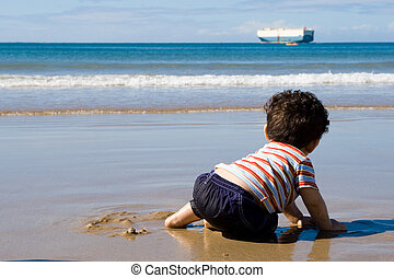 baby watching ship on ocean - a baby boy sitting on the...