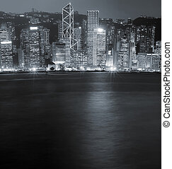 Night scenes of Victoria harbor in Hong Kong - It is night...
