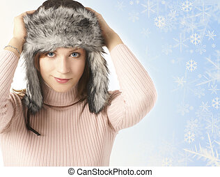 Attractive young woman wearing winter hat  isolated on white