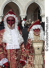 masked persons in magnificent red and gold costume on San...