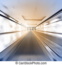 Escalator in motion - abstract business and architectural...