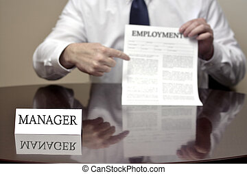 Manager At Desk Holding Employment Document - Manager...