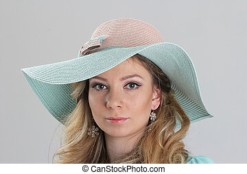 Blond girl, portrait in turquoise hat