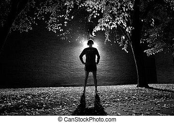 backlit person - a person backlit at night