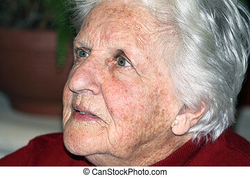 octogenarian - portrait of an old woman with white hair and...