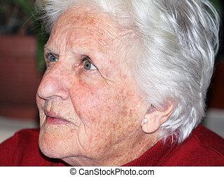 elderly woman - portrait of an elderly woman showing crucial...