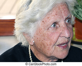 elderly woman portrait with a stunned expression on her face