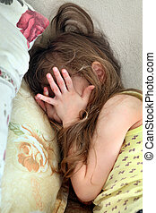 Child Abuse - Scared Little Girl on the Bed in the Domestic...