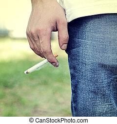 Person with Cigarette - Toned Photo of Man hold a Cigarette...