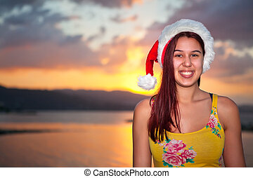 Jamaican Christmas - Young woman enjoying Christmas on a...