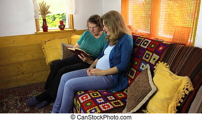 grandma read book - Pregnant granddaughter woman with...