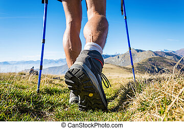 mountain boots - Trekker walking on the mountains Italian...
