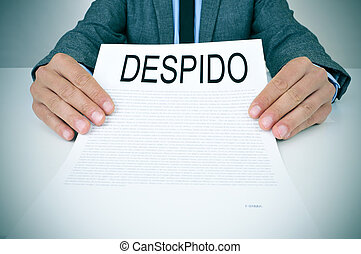 businessman shows a document with the text despido,...