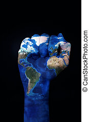 raised fist patterned with a world map (furnished by NASA) -...