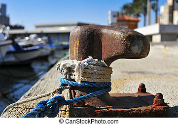 ropes tied on a rusty mooring