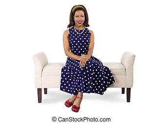 Woman in Polka Dot Dress Sitting - woman wearing a blue...