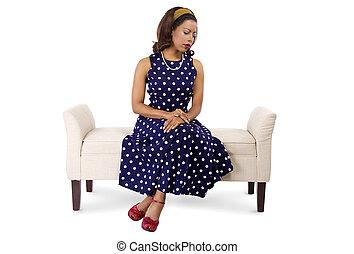 Woman in Polka Dot Dress Sitting - woman wearing a blue...
