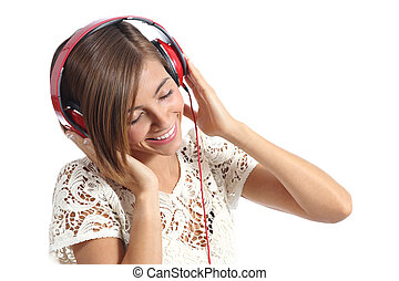 Candid happy woman feeling the music from red headphones...