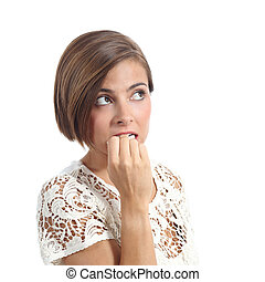 Nervous pensive woman biting nails isolated on a white...