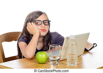 a tired little girl with her computer and an apple