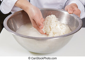 Cook washes rice - Get rice clean Close-up of hands of a...