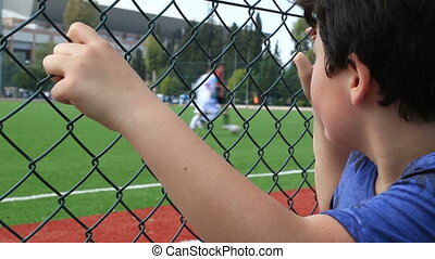 Child watching football match - Soccer fan watching match...