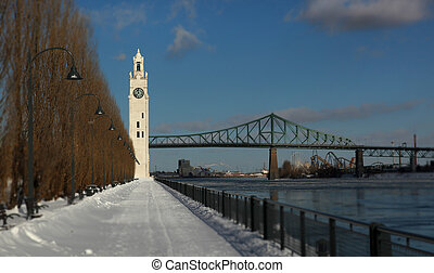 Clock tower and Jacques Cartier bridge during winter in the...