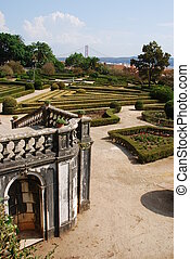 Enchanted Ajuda garden with April 25th bridge in Lisbon, Portugal