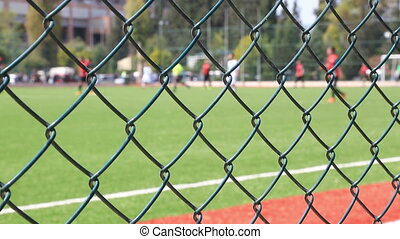 Soccer game behind the fence - Football match behind the...
