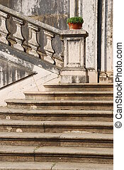 Architectural detail of a antique staircase with stone steps...