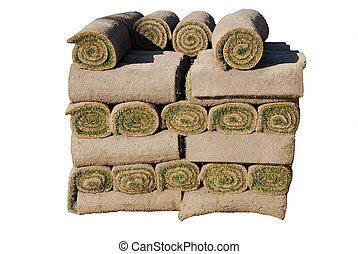 Rolls of sod isolated on white background