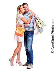 Happy couple with shopping bags. - Happy couple with...
