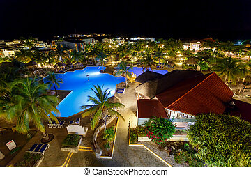 View on hotel and swimming pool at night, Cayo Largo, Cuba