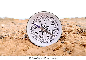 Orientation Concept Metal Compass on a Rock in the Desert