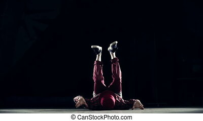 Headspinning - B-boy performing cool headspin in the dark...