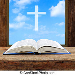 Bible open christian cross light sky view window wooden shallow DOF