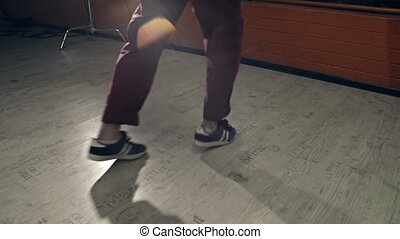 Moonwalking - Close up of two dance partners practicing in...