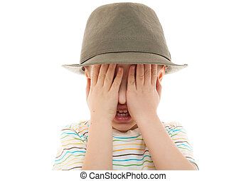 child hide peek a boo hat retro portrait closeup