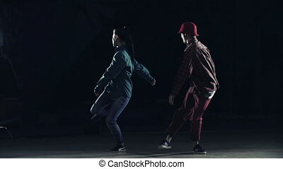 Youth Culture - Two hip hop dancers breakdancing in the dark...