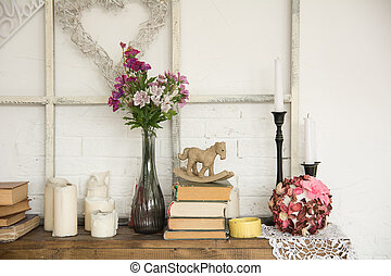 Interior with books flowers and candles - Interior with...