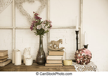 Interior with books, flowers and candles. Bright background...