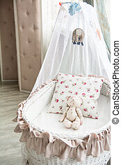 Retro interior children's bedroom with a wicker crib and...