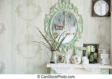 Vintage interior with mirror and a table with a vase and...