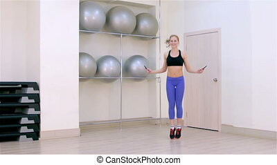 Fitness Jumping rope - Young woman jumping on a rope