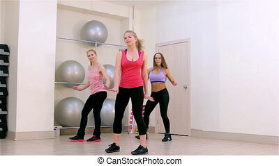 Fitness. Dance aerobics - Young women doing dance aerobics