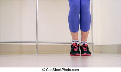 Fitness Jumping rope closeup - Young woman jumping on a rope...