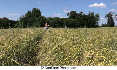 woman rye field summer - beautiful young pregnant woman walk...