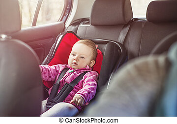 Mother and child in the car - Mother driving a car, having...