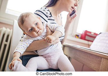 Young mother working from home - Young mother in home office...
